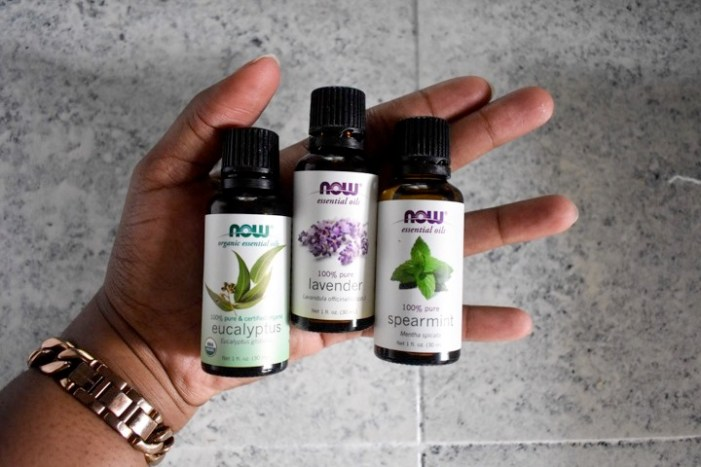 holding NOW essential oils