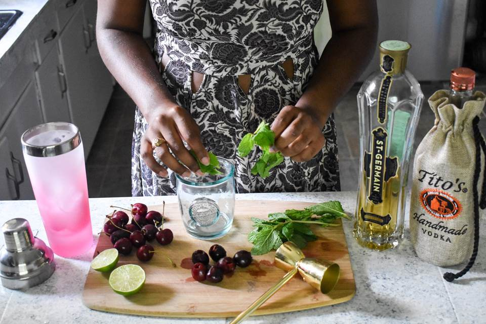 Your new favorite summer drink: the cherry elderflower smash is quick, easy, and delicious! Made with St. Germain elderflower liqueur, fresh cherries, mint, a squeeze of lime, soda, and Tito's handmade vodka by Dash of Jazz.