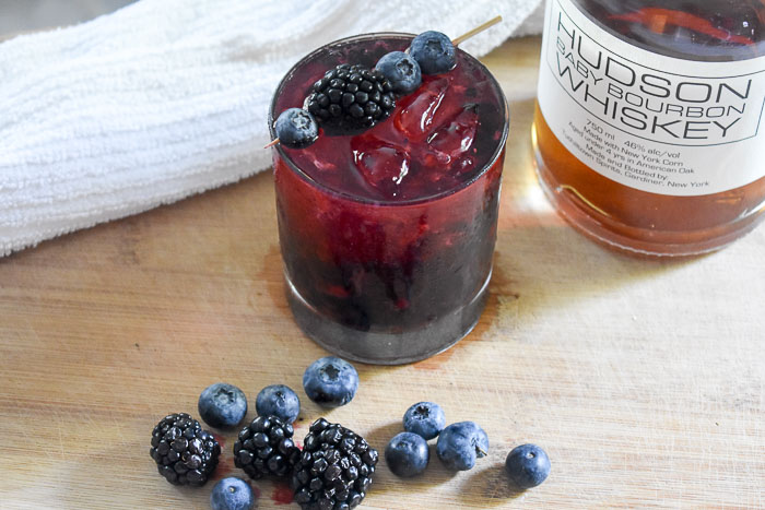 The bubbly bourbon & berries cocktail is a deliciously fun drink made simply with bourbon whiskey, champagne, and black and blueberries.