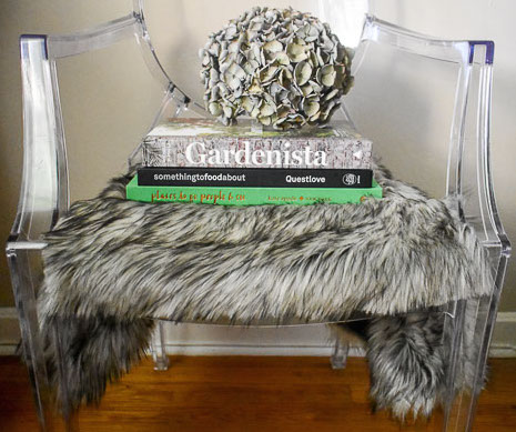 A DIY faux fur seat covers tutorial to inexpensively style ghost chairs anywhere in your space for a luxurious touch on a budget as part of the One Room Challenge. by Dash of Jazz
