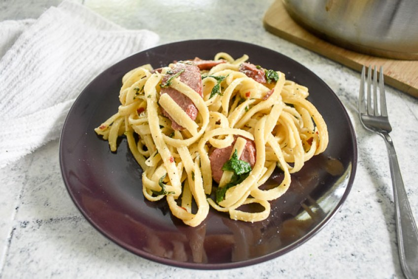 A quick and easy, one-pot sausage & spinach pasta meal perfect for weeknight dinners and workweek lunches in under 30 minutes! Recipe by Dash of Jazz