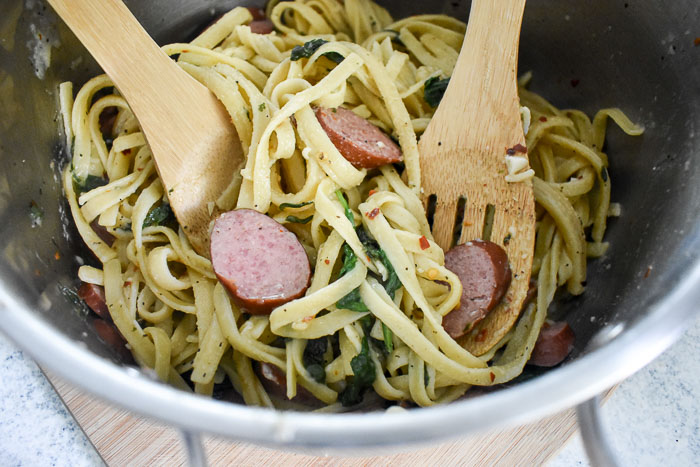 fettuccine pasta, turkey sausage, spinach, herbs, and spices all cooked in one pot