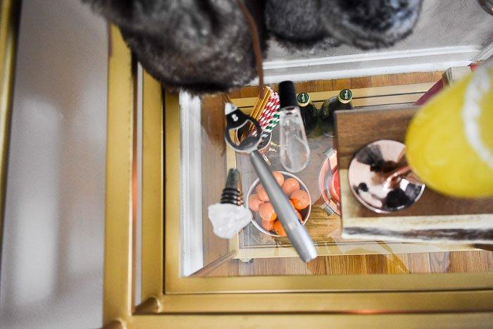 A bottle opener on a bar cart in Dash of Jazz's 6 easy bottle gift ideas guide