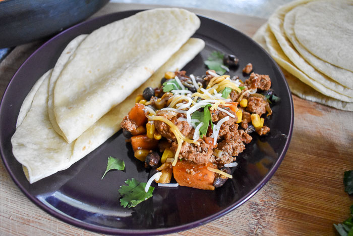 Spicy Chipotle Skillet Meal comes together in under an hour in one pan and is full of flavor and good for your ingredients. Serve it over rice, wrap it up in a tortilla or eat it as is! Recipe by Dash of Jazz