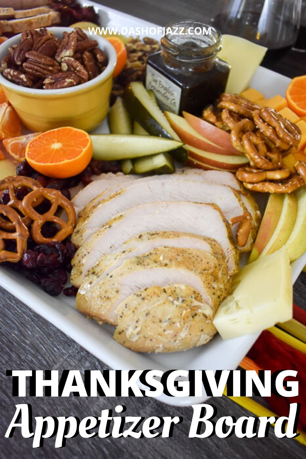 photo of sliced turkey on Thanksgiving appetizer board with text overlay