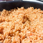 Closeup on a finished pot of Nigerian jollof rice