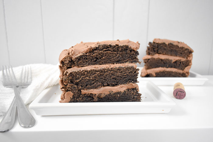 two slices of three layer red wine chocolate cake