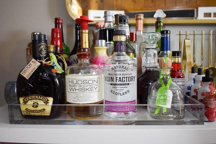 assorted liquors and mixers on an acrylic tray