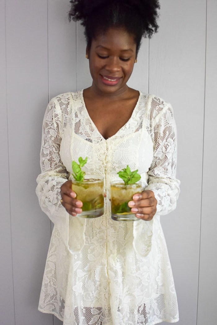 Dash of Jazz holding two easy lavender mint julep cocktails