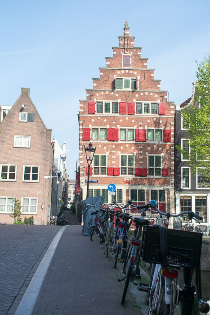 Bikes lined up along rain in Amsterdam's Red Light District