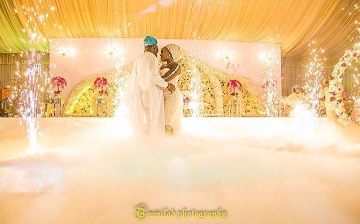 Yoruba bride and groom dancing at traditional wedding ceremony in Lagos, Nigeria