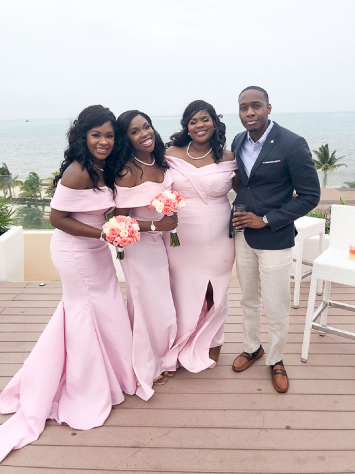 bridesmaids in pink dresses and guests at destination wedding in Cancun, Mexico