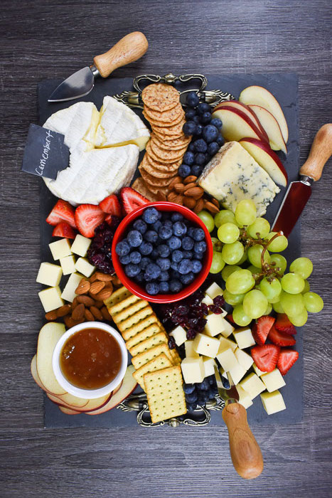 How to build a red, white & blue cheese board perfect for any patriotic celebration including product and drink pairing recommendations by Dash of Jazz #redwhiteandblue #cheeseboard #appetizer #easyappetizer #fourthofjuly #partyfood