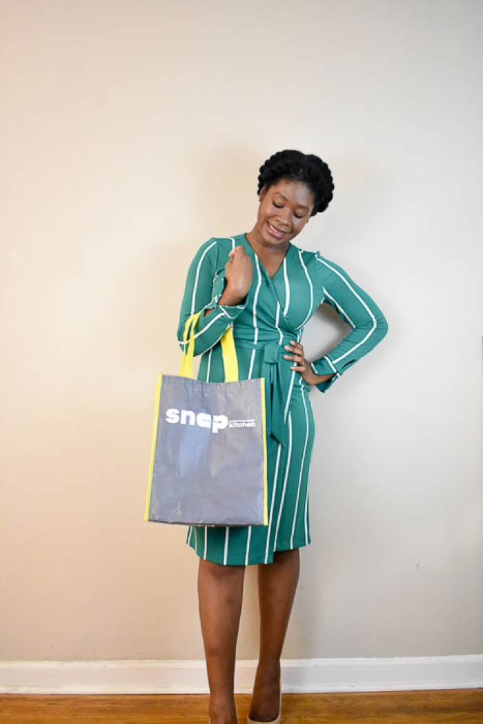 Dash of Jazz holding Snap Kitchen reusable bag