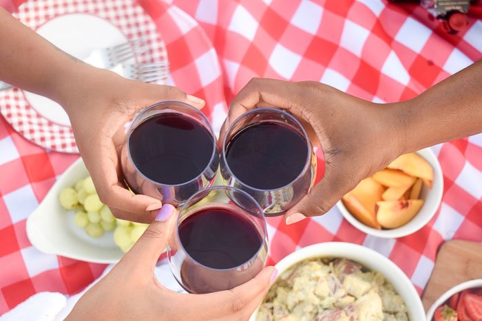 toasting three glasses of red wine