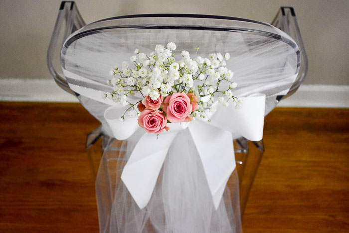 bridal shower chair adorned with babys breath and spray roses