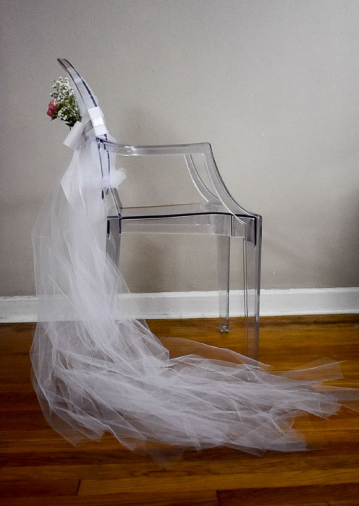 decorated bridal shower chair with white tulle train