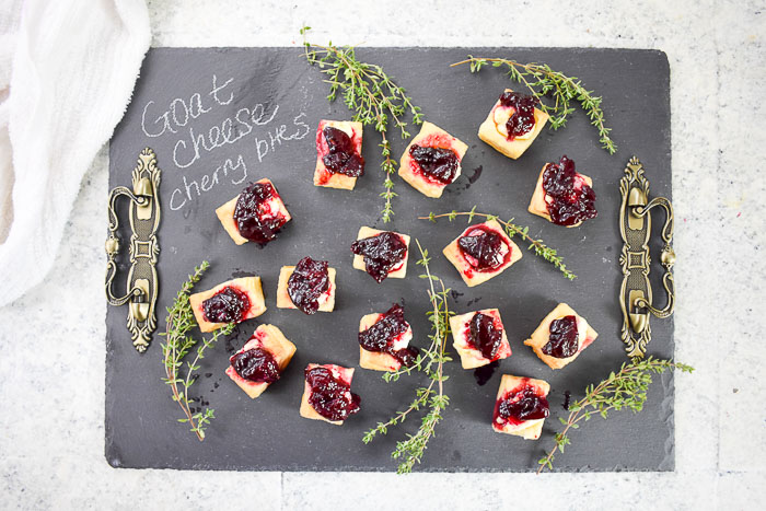 goat cheese cherry appetizer bites on slate cheese board