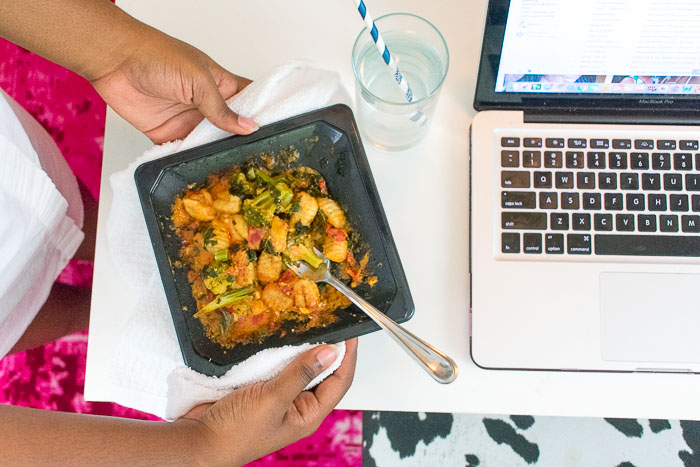 EatingWell frozen entree next to laptop