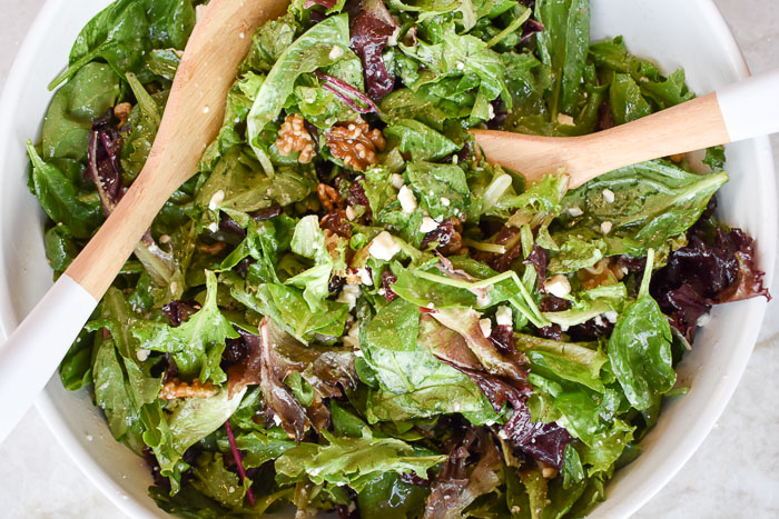 tossed green salad with walnuts, feta cheese, dried cranberries, and champagne salad dressing
