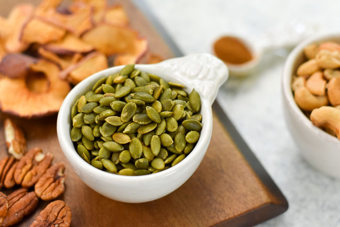 pepitas (pumpkin seeds) in measuring cup