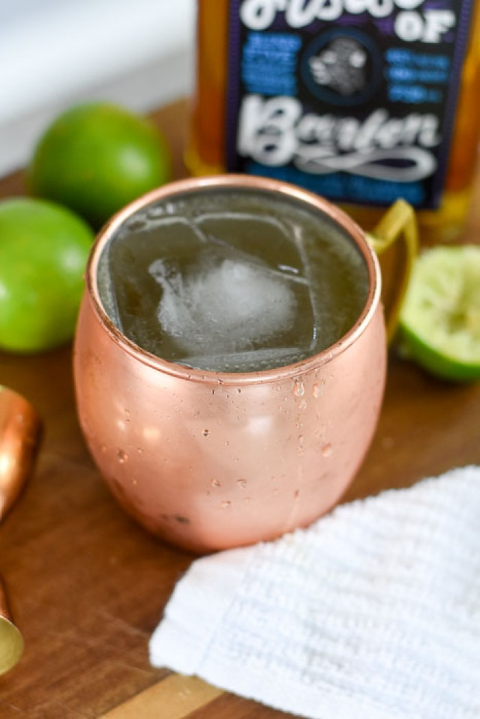 copper mug with bourbon mule cocktail