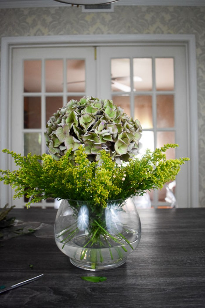 antique hydrangea and goldenrod in vase on tabletop