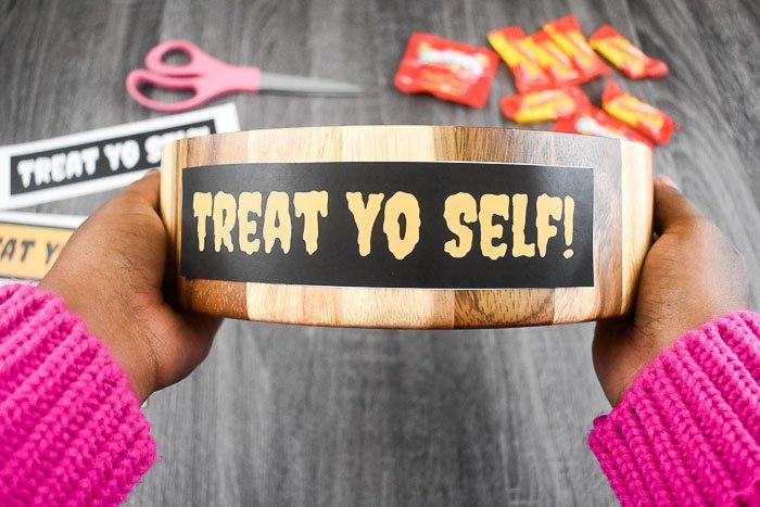 holding treat yo self candy bowl