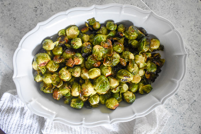 serving bowl of crispy maple roasted brussels sprouts