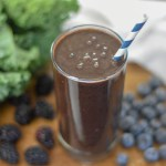 blacker the berry smoothie in glass with striped straw