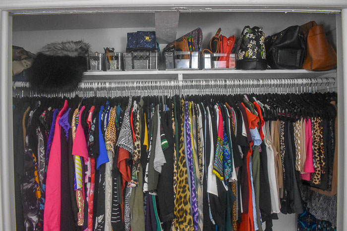 clothes and handbags organized in closet