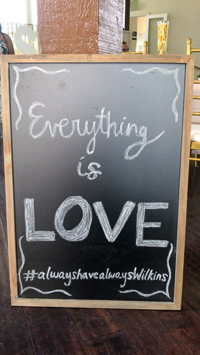 Everything is Love bridal shower welcome sign on chalkboard