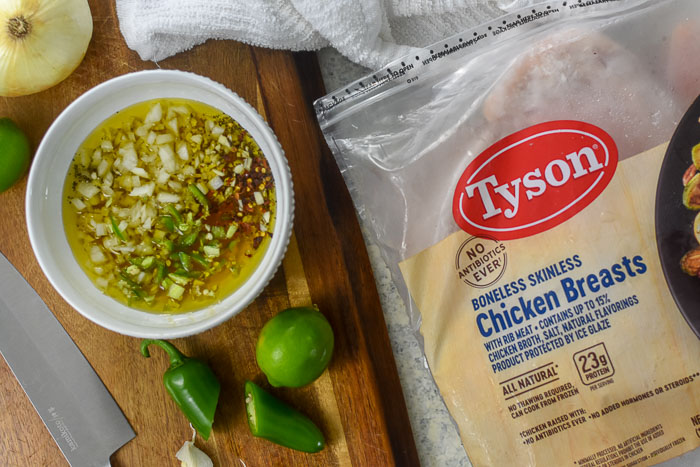 Tyson chicken breast and marinade in bowl