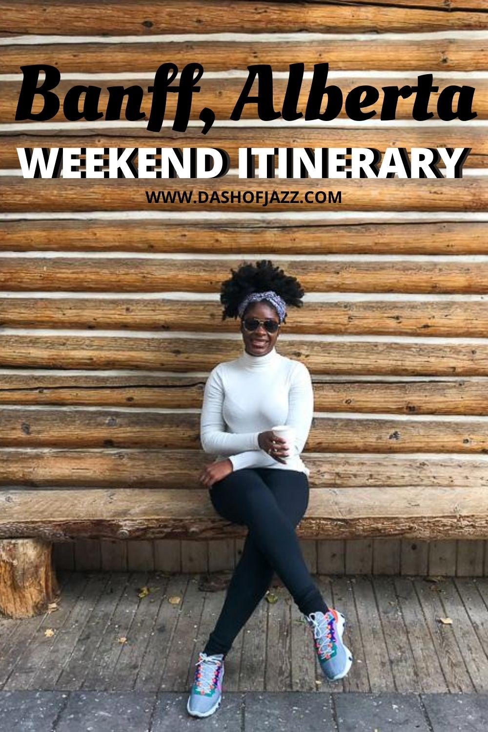 "Jazzmine sitting in front of log cabin wall holding coffee with text overlay ""Banff, Alberta weekend itinerary"""