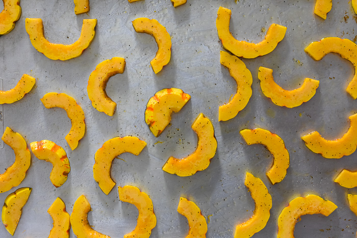 slices of delicata squash on sheet pan