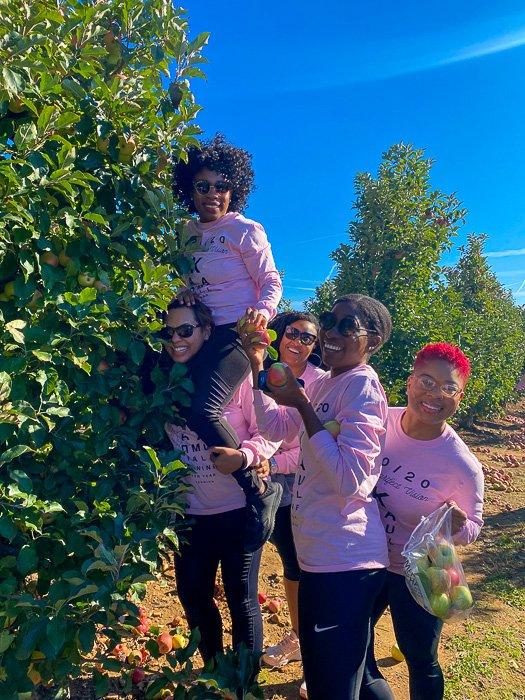 black women picking apples