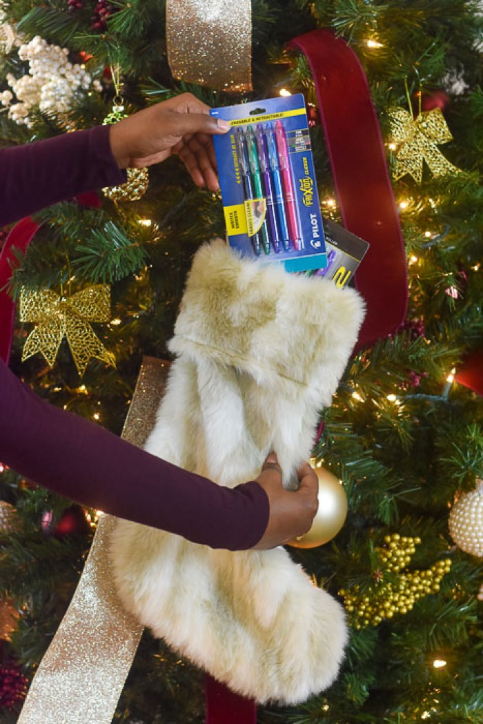 stuffing a stocking with Pilot pens