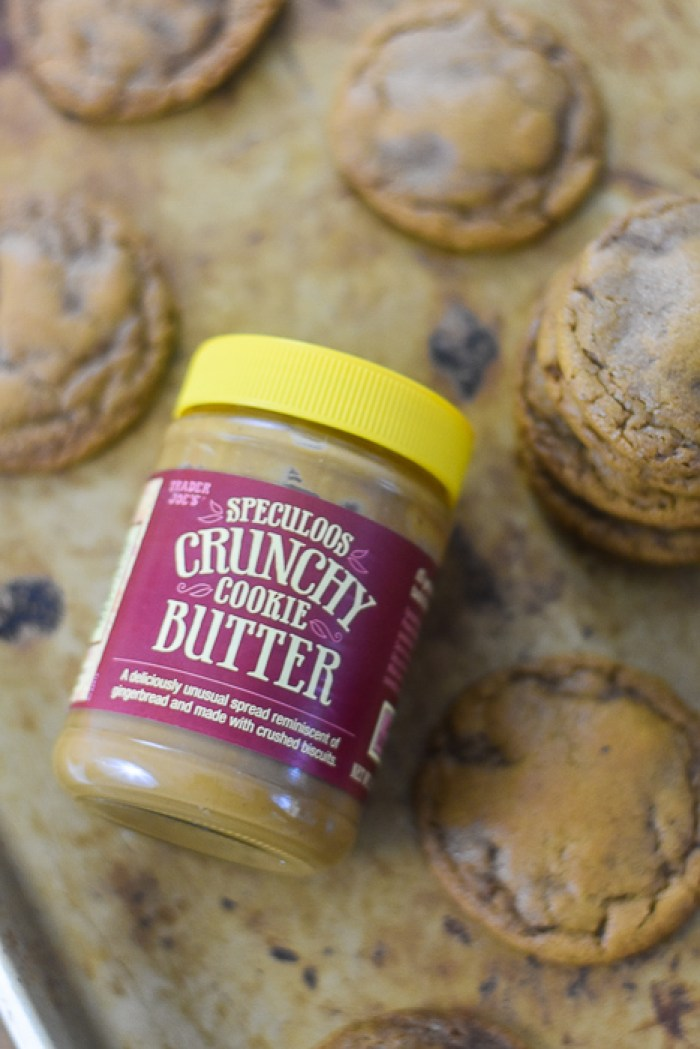 jar of speculoos cookie butter on baking sheet with cookie butter cookies