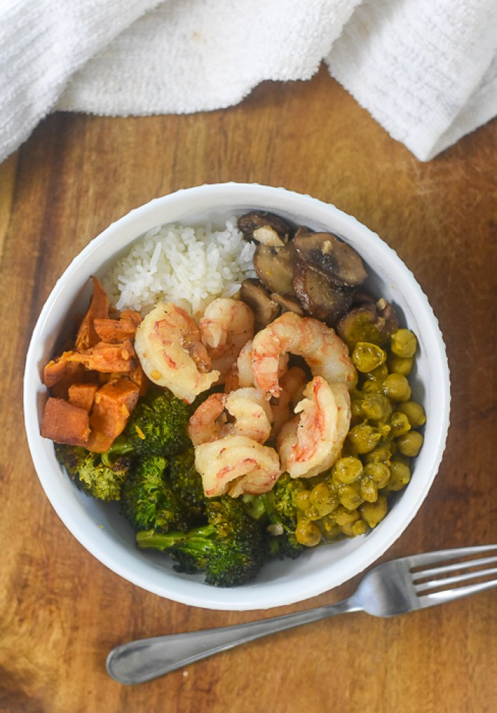chickpea curry, shrimp, broccoli, mushrooms, rice, and sweet potatoes in a power bowl