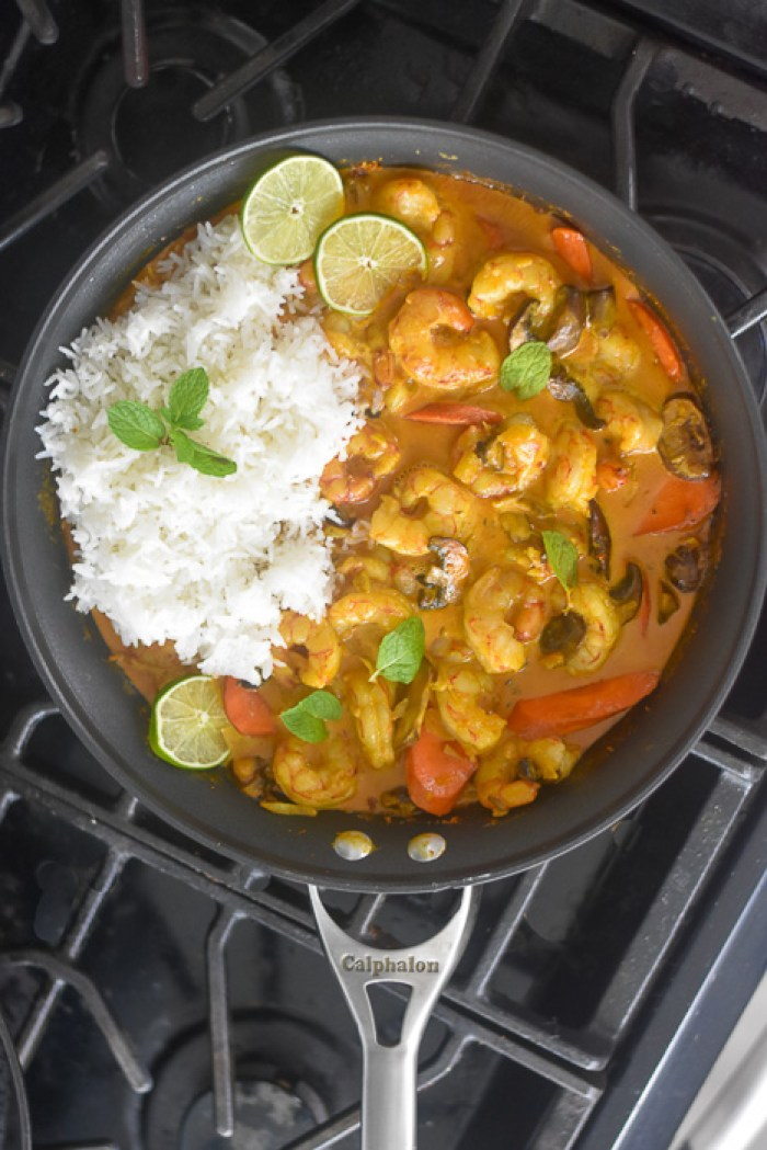 pan of coconut curry shrimp & veggies with rice
