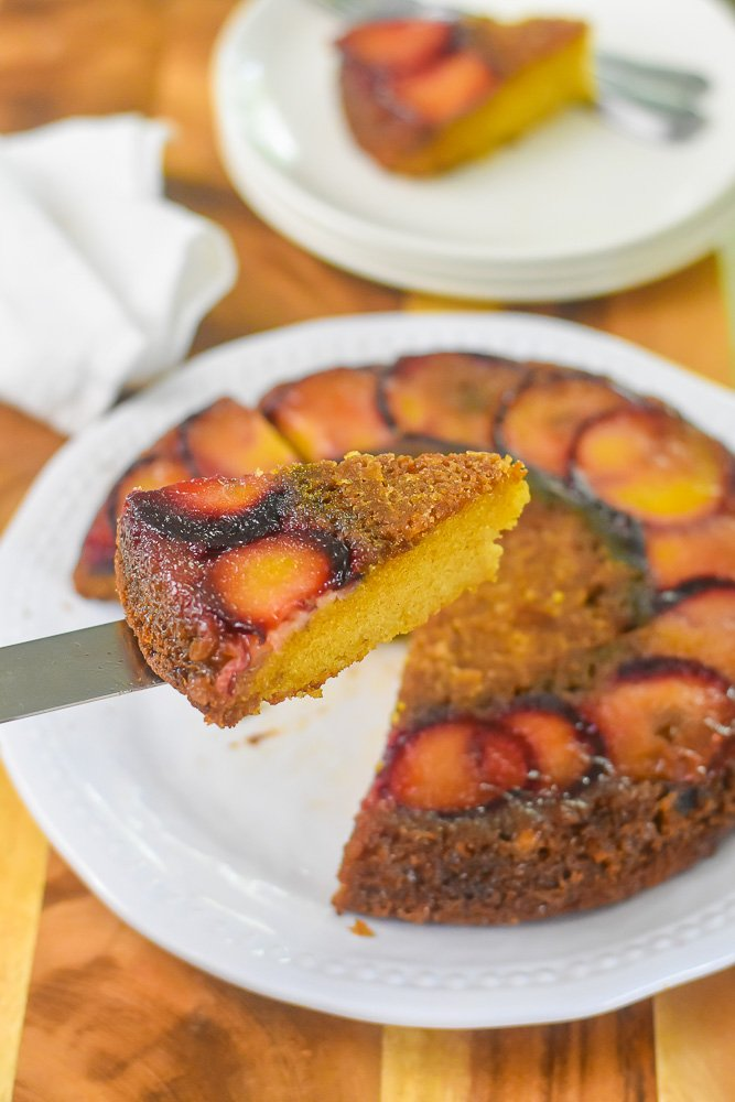 serving slice of bourbon plum upside down cake