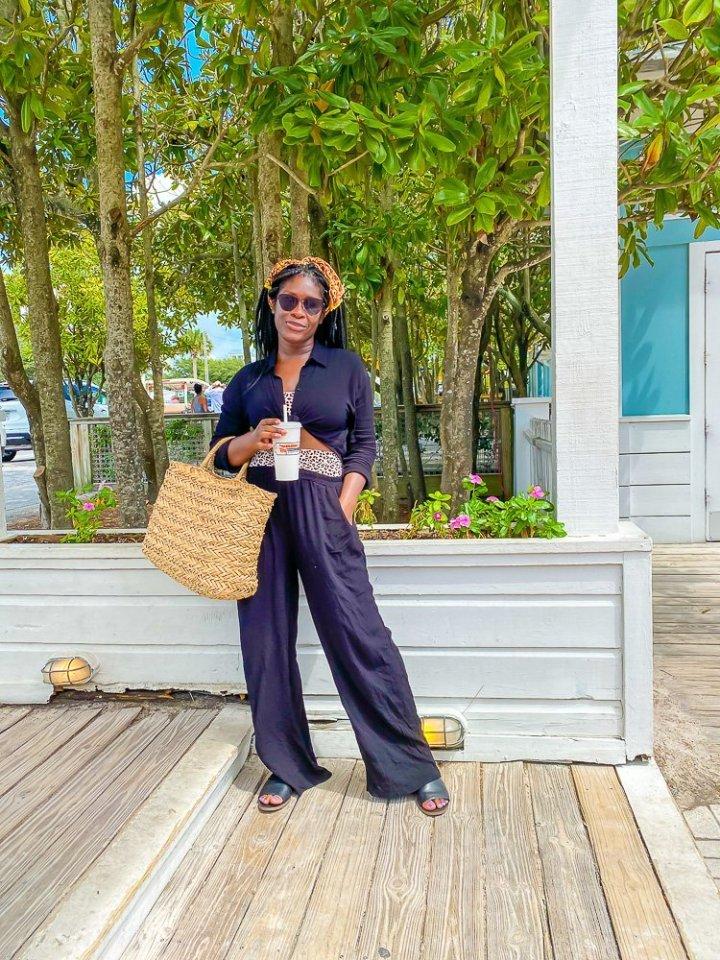 Jazzmine holding beach bag on patio in 30A, Florida