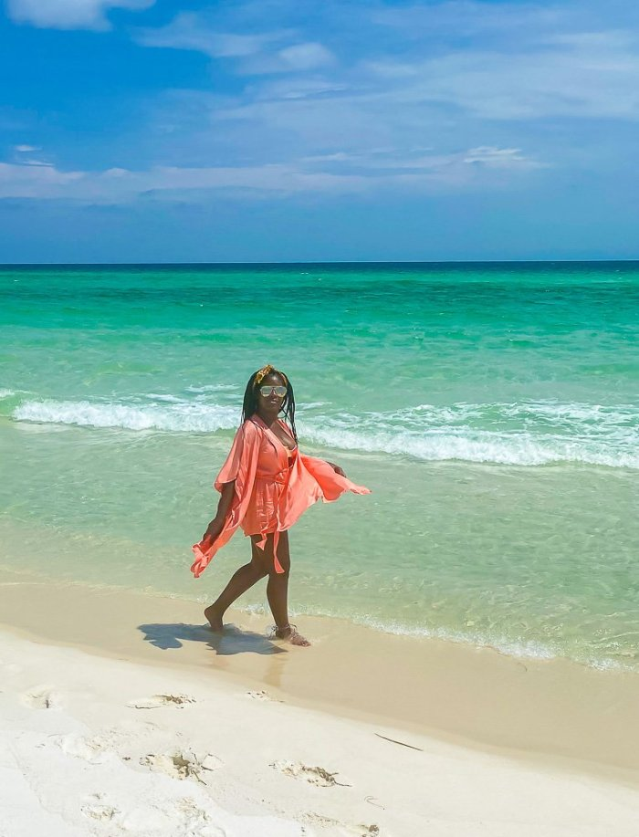 Jazzmine walking along Navarre Beach shoreline