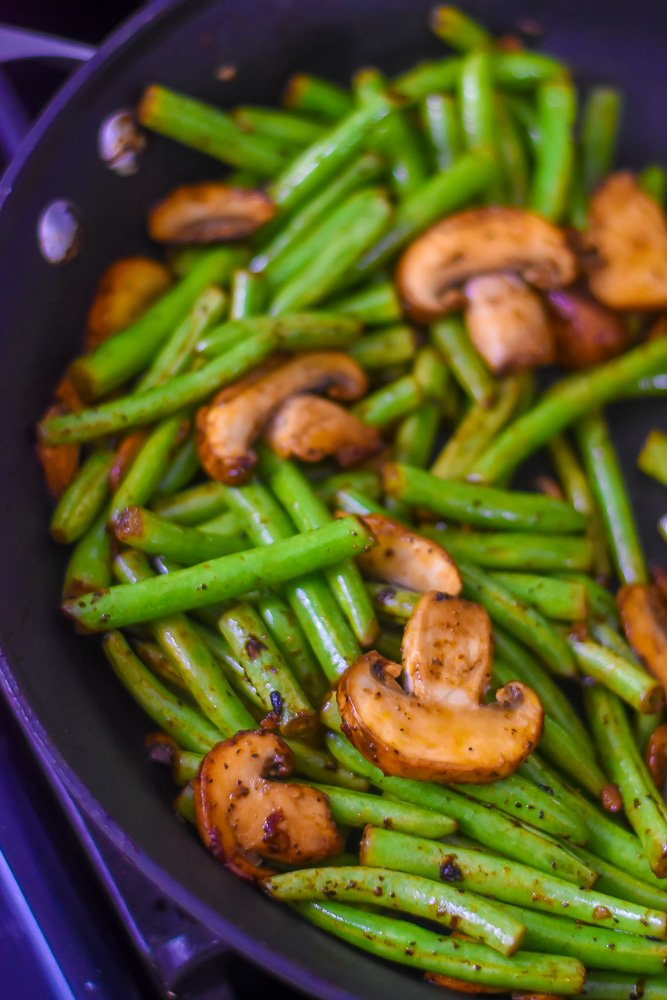 sauteed green beans and sliced mushrooms in skillet
