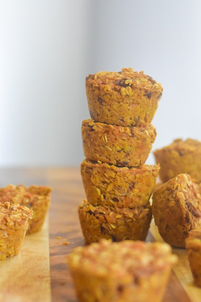 stack of sweet potato baked oatmeal muffins on cutting board
