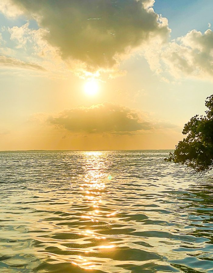 sun setting over water near Isla Holbox, Mexico