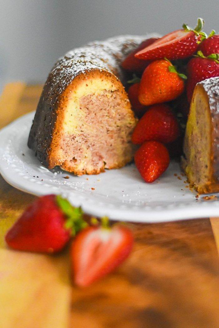 strawberry swirled pound cake garnished with fresh berries.