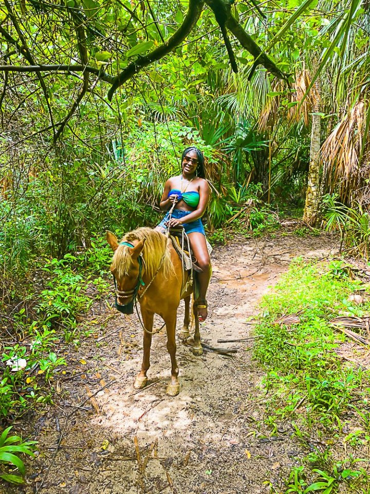 Jazzmine on horse in Cozumel jungle.