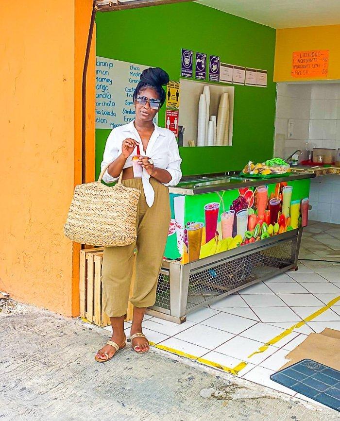 Jazzmine outside ice cream shop on Cozumel, Mexico, holding chamoyada.