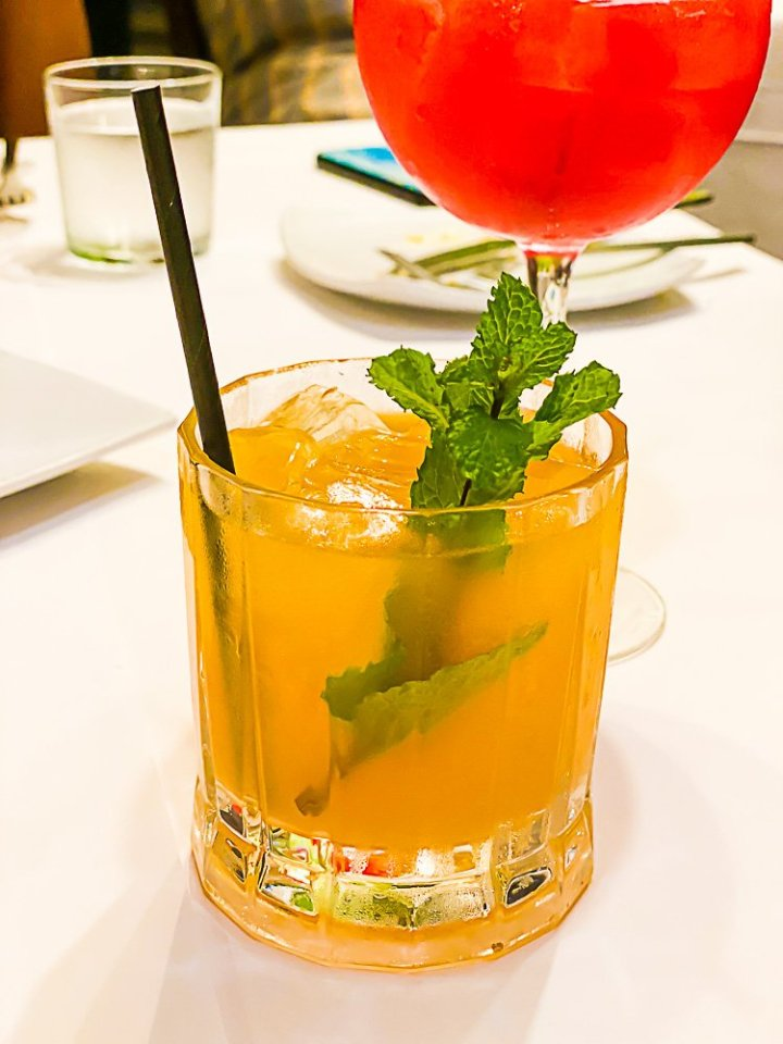 Down Yonder cocktail garnished with fresh mint sprig.